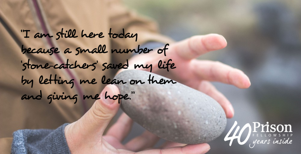 """I am still here today because a small number of 'stone-catchers' saved my life by letting me lean on them and giving me hope."" - quote from Gavin against a background of someone holding a stone."
