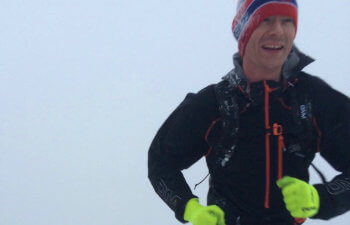 PF Volunteer Adam running in the snow