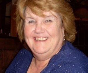 Photo of PF volunteer Linda Brennan, smiling at the camera