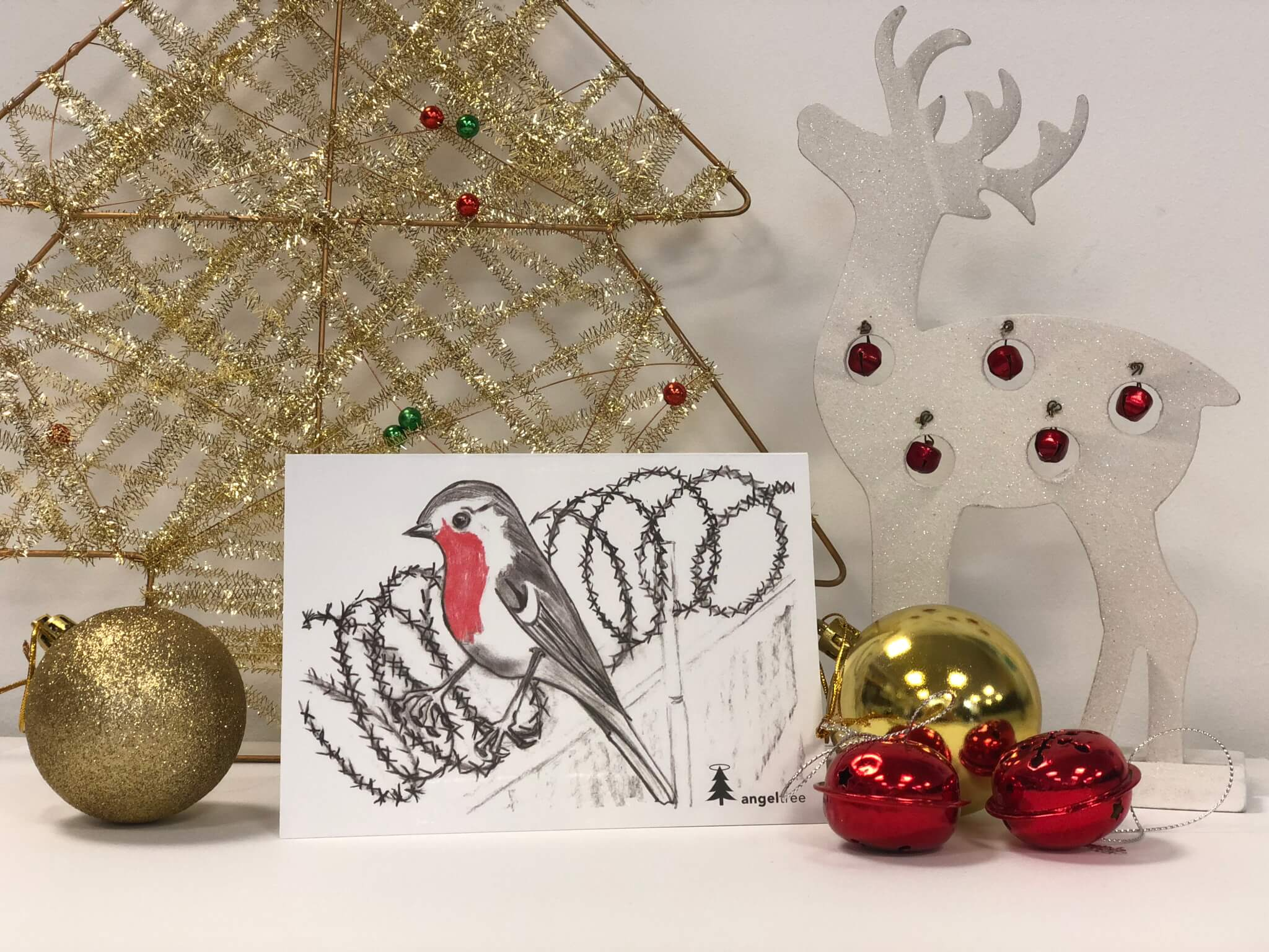 PF Christmas card for 2018 - featuring a robin sitting on barbed wire