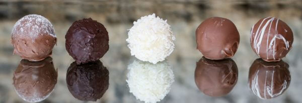 Picture of five chocolate truffles, made by Grace Chocolates